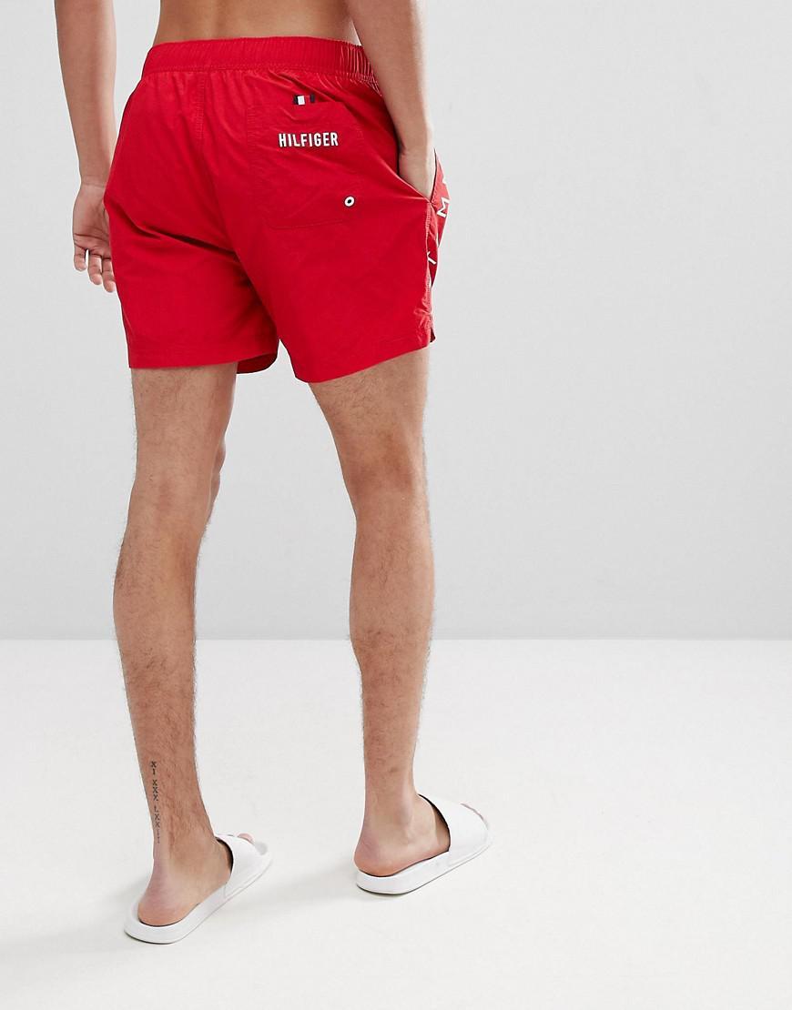 cf8961ee3e37 tommy-hilfiger-red-Short-Drawstring-Side-Stripe-Logo-Swim-Shorts-In-Red.jpeg