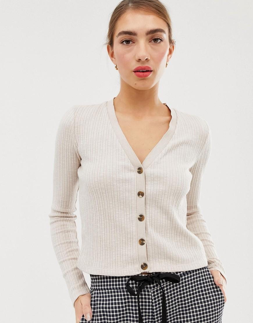 1787e9044af51 Lyst - Stradivarius Button Front Ribbed Top In Beige in Green