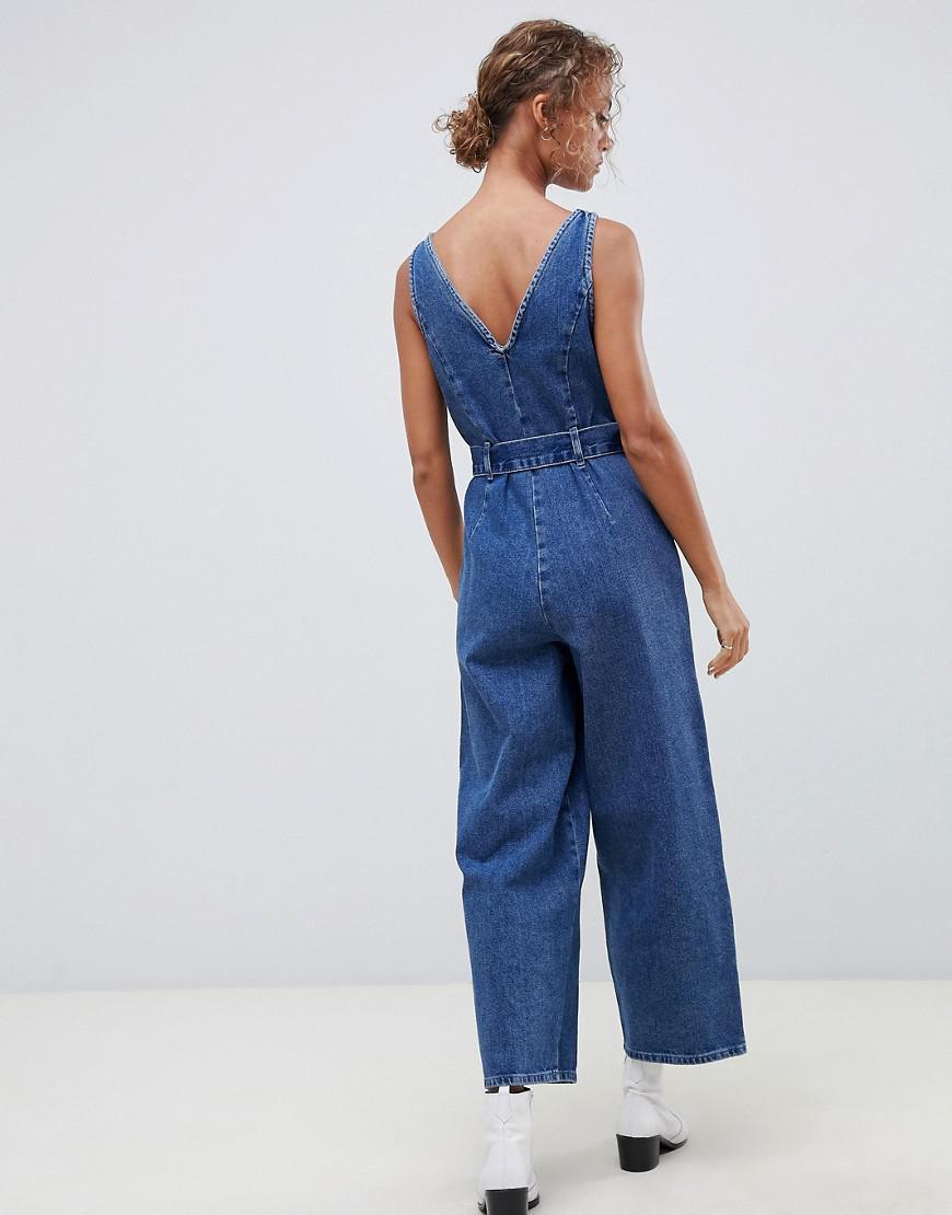 e3d9796adbf6 Lyst - ASOS Denim Button Through Jumpsuit In Midwash Blue in Blue