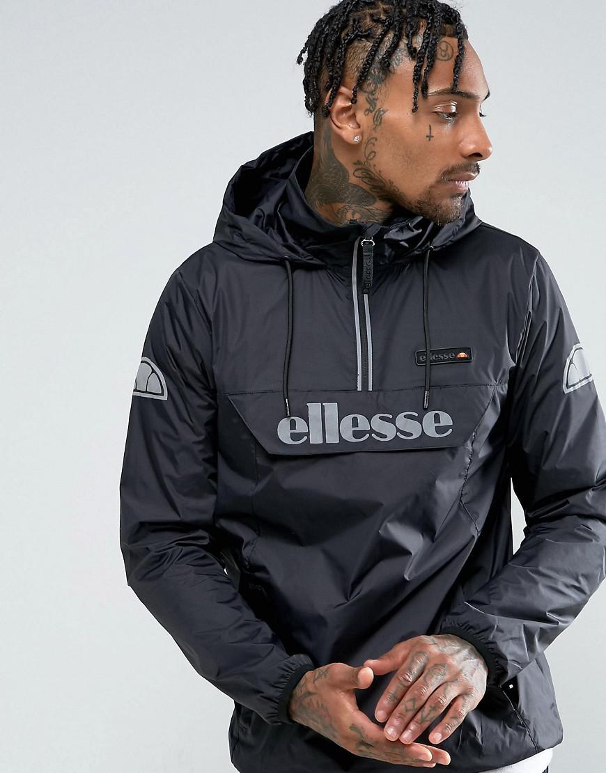 lyst ellesse overhead jacket with reflective logo in black in black for men. Black Bedroom Furniture Sets. Home Design Ideas