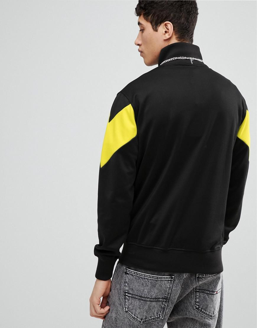 8a7f0e18 Ellesse Half Zip Sweatshirt With Chevron Panel In Black for men