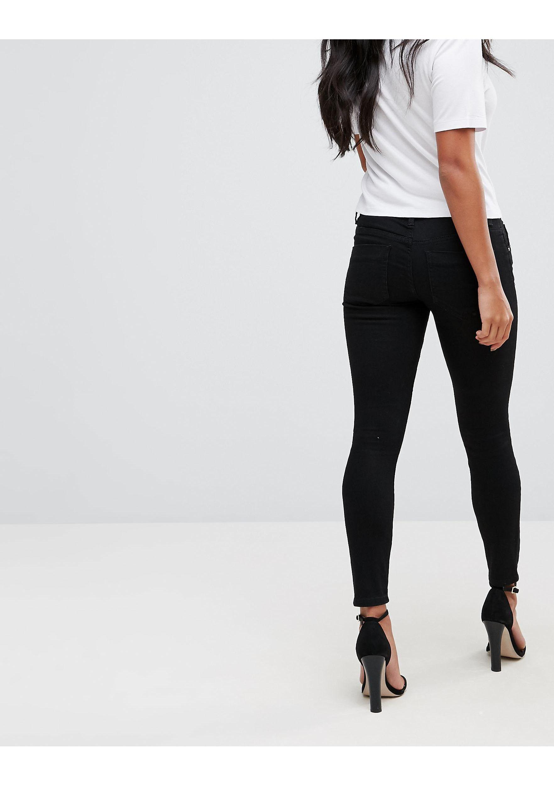 ASOS DESIGN PETITE - Whitby - Jean skinny taille basse - pur Jean ASOS en coloris Noir