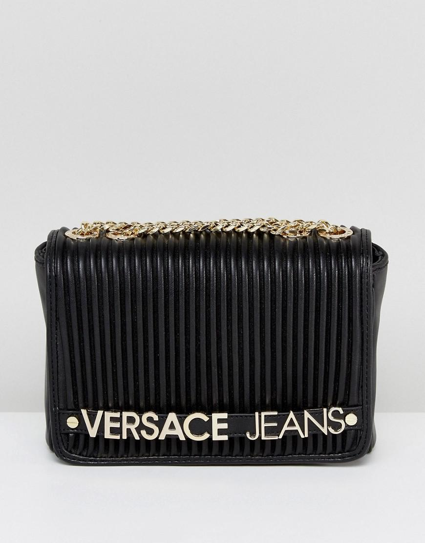 f05744443fe3 Gallery Women S Green Bags. Lyst Versace Jeans Plisse Cross Body With Gold  Logo Lettering In Black
