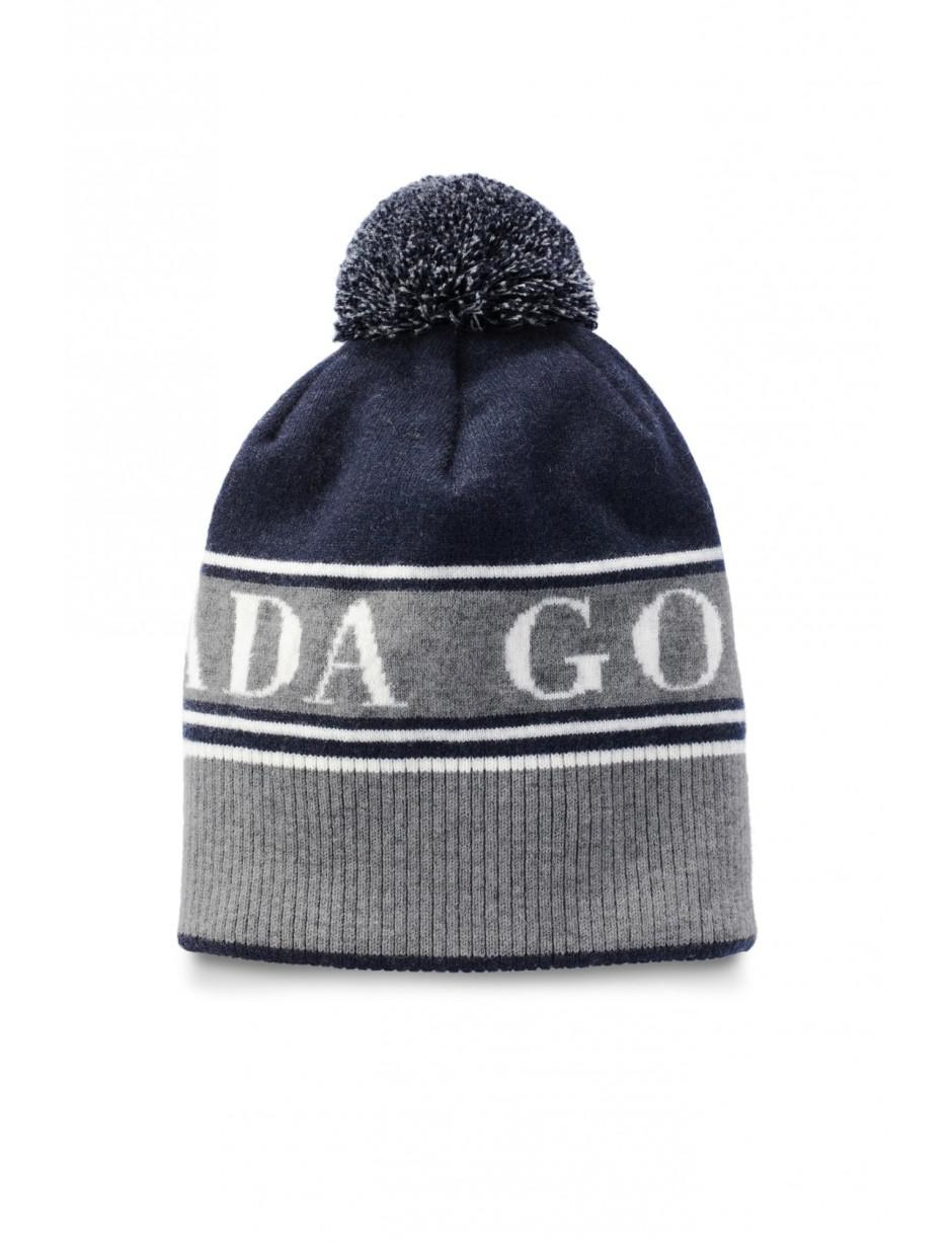 4ffa4a533c9 Lyst - Canada Goose Men s Merino Logo Pompom Beanie Hat in Blue for Men -  Save 1%