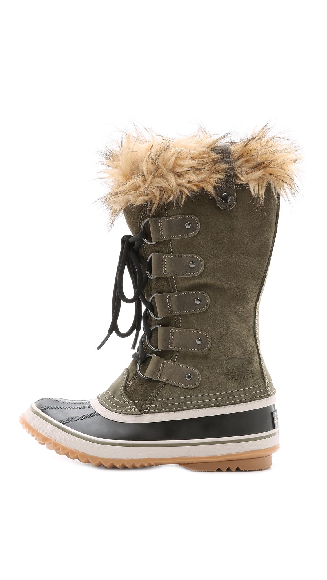 sorel joan of arctic boots black in green nori lyst. Black Bedroom Furniture Sets. Home Design Ideas