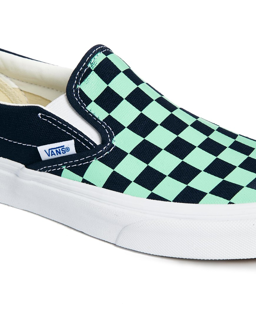 green checkerboard vans slip on