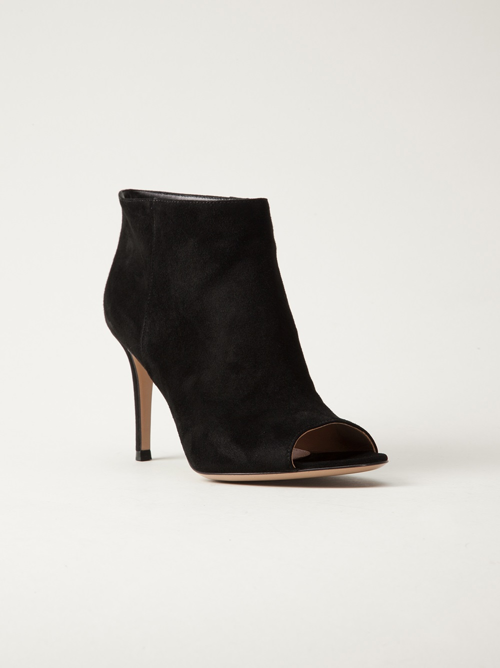 You'll be rockin' these black booties everywhere! They feature a gold back zipper closure with a fringe detail, cut outs on the side for a unique look, a peep toe, and a high block heel.
