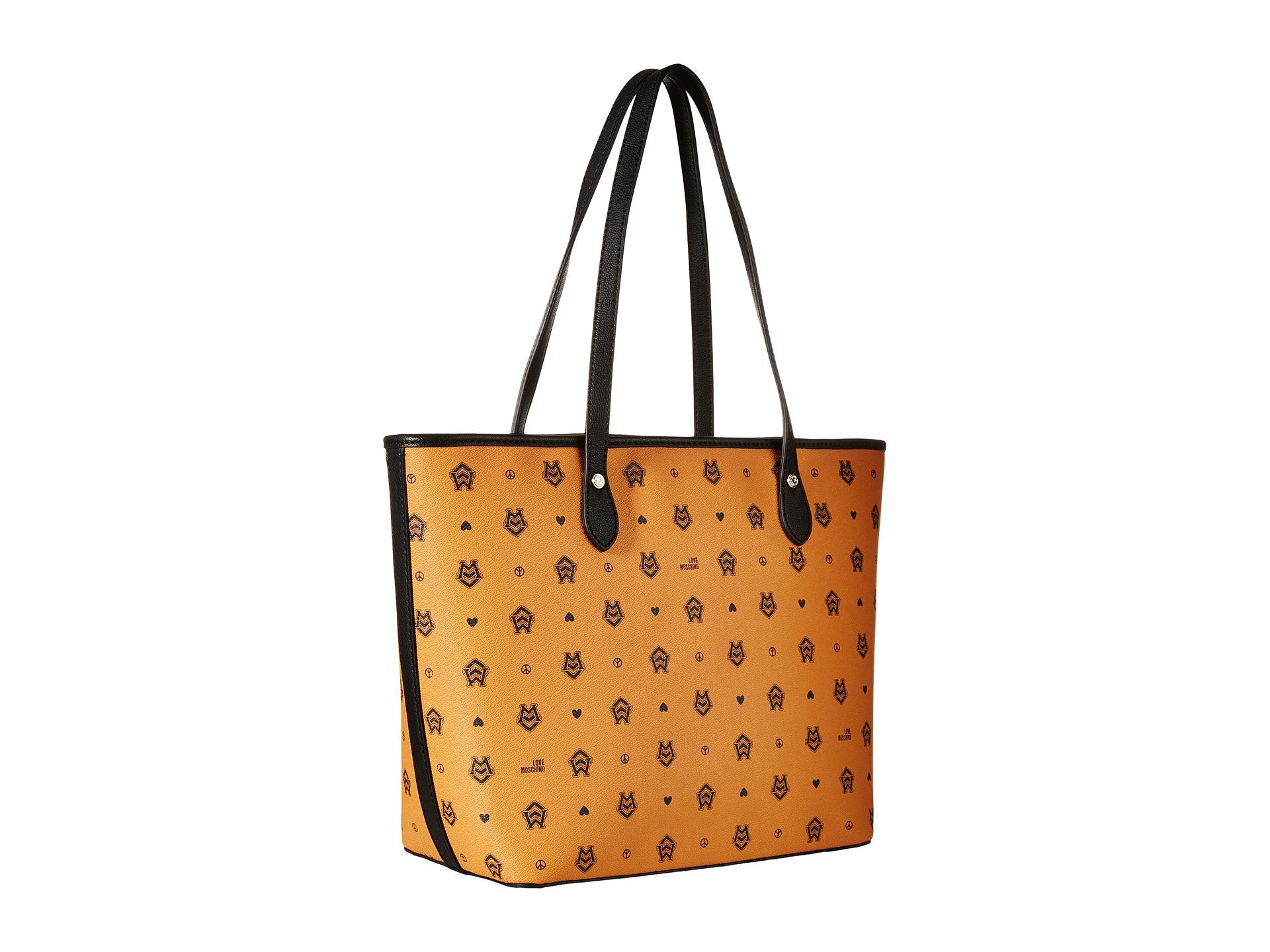 love moschino monogram tote bag in brown orange brown lyst. Black Bedroom Furniture Sets. Home Design Ideas