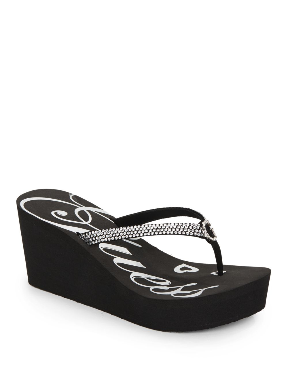 e0330a2033408a Lyst - Guess Seespray Jeweled Wedge Thong Sandals in Black