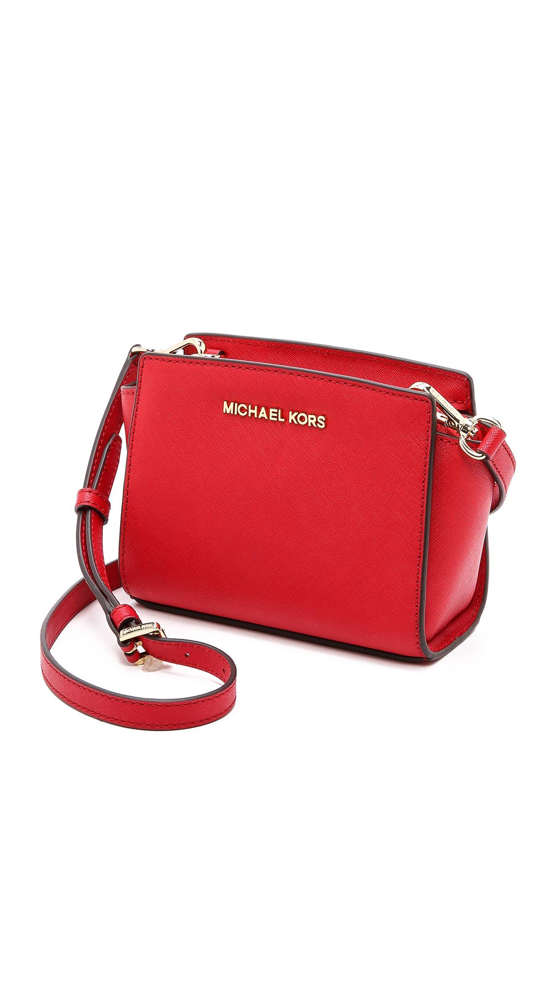 069b2b4f90e53 ... purchase michael michael kors selma mini messenger bag pale pink in red  lyst 3cc33 9561b