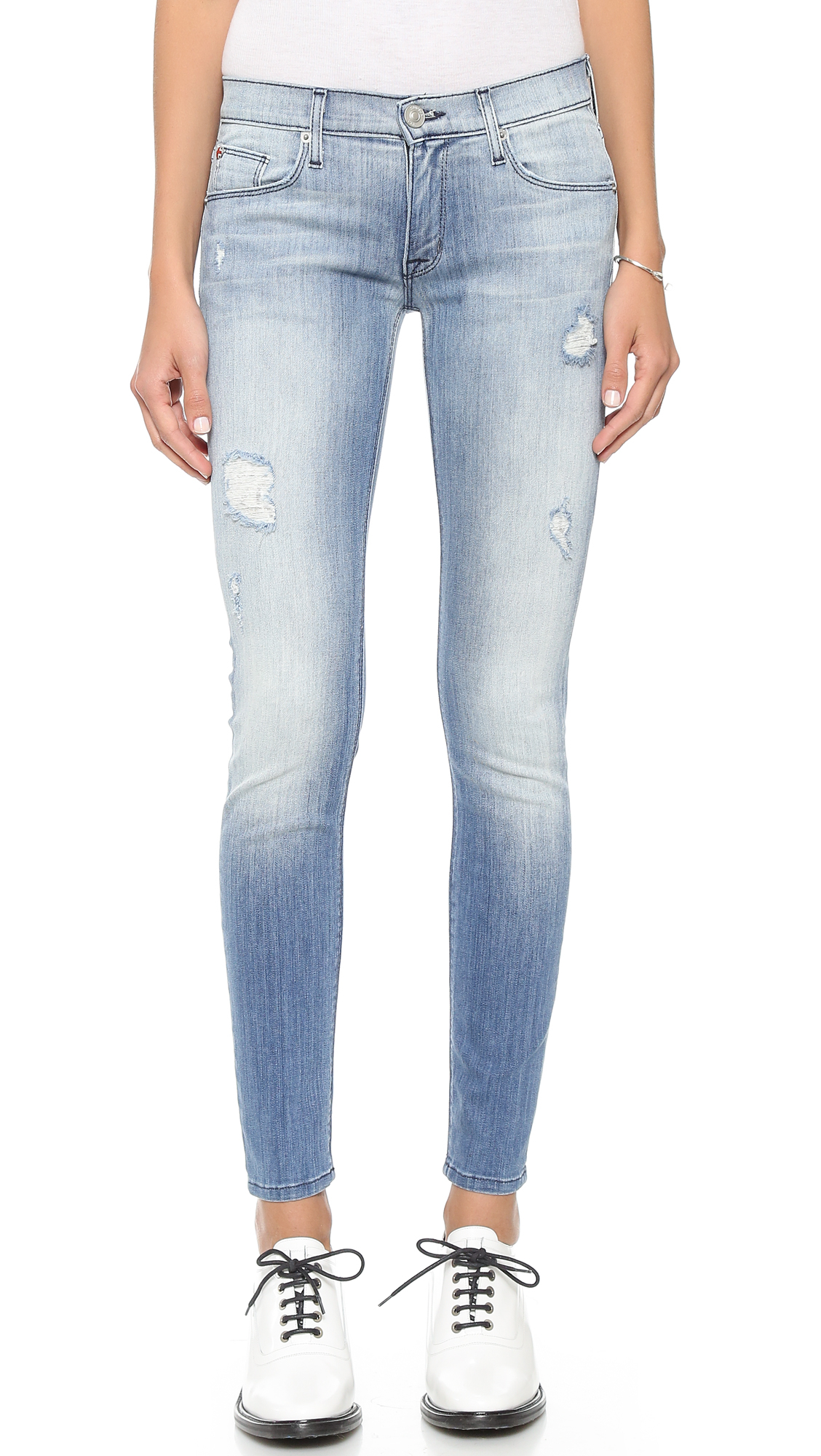Pair cropped jeans with ankle boots. Cropped jeans are ideal for ankle boots. Choose a pair of cropped jeans that stop about 1 inch ( cm) above your boots.