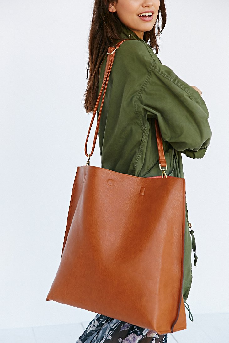 eedfecdfbfd Urban Outfitters Brown Oversized Reversible Vegan Leather Tote Bag