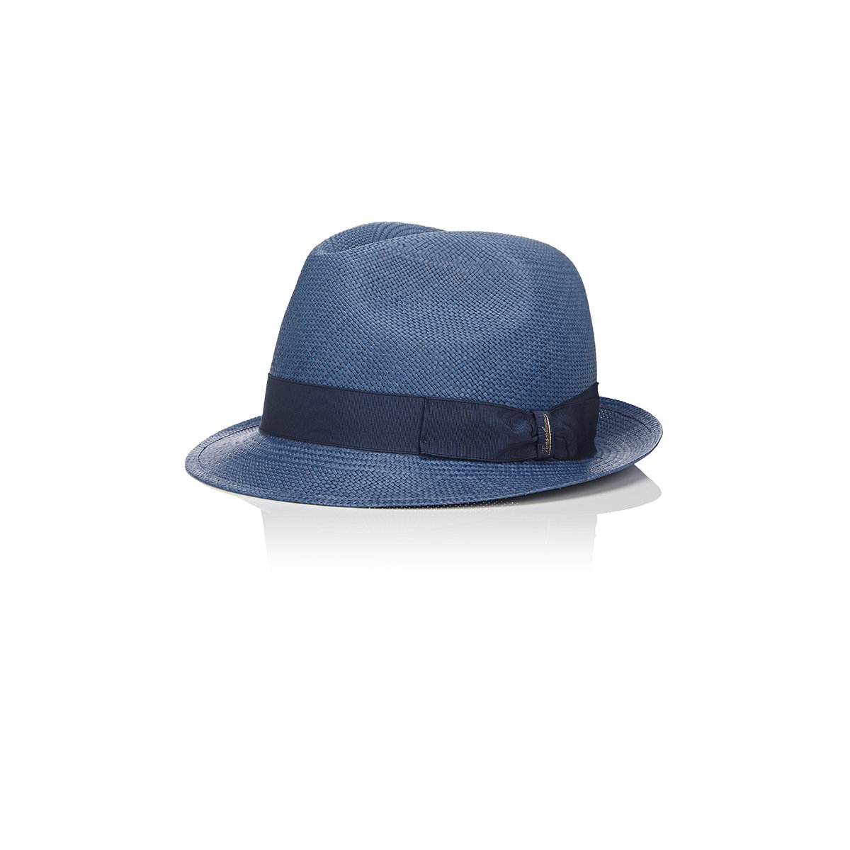 Shantung Straw Fedora Hat is a stunning new addition to Carlos Santana's eclectic collection of straw fedora hats. Blocked into a classic pinch front fedora style, the Brahman boasts a lightly vented navy blue crown offset with striking diagonal, natural-toned