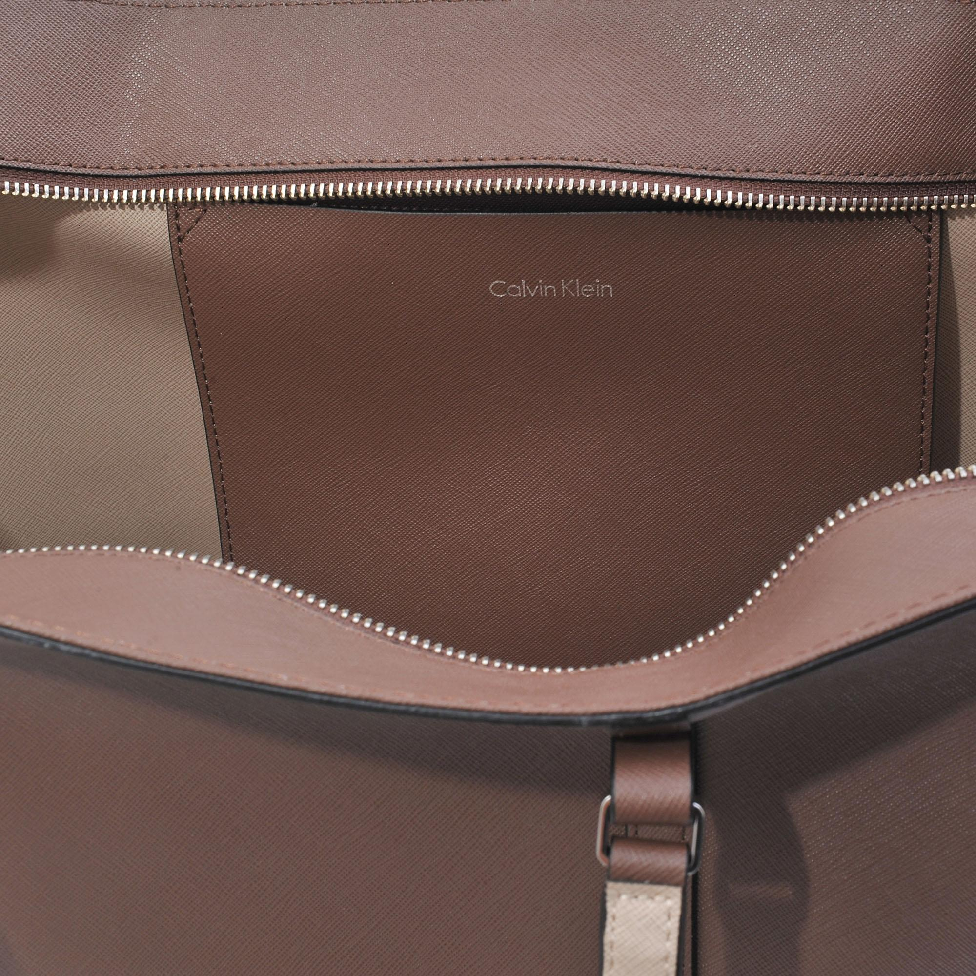 663588de73 Calvin Klein East West Sophie Saffiano Tote in Brown - Lyst