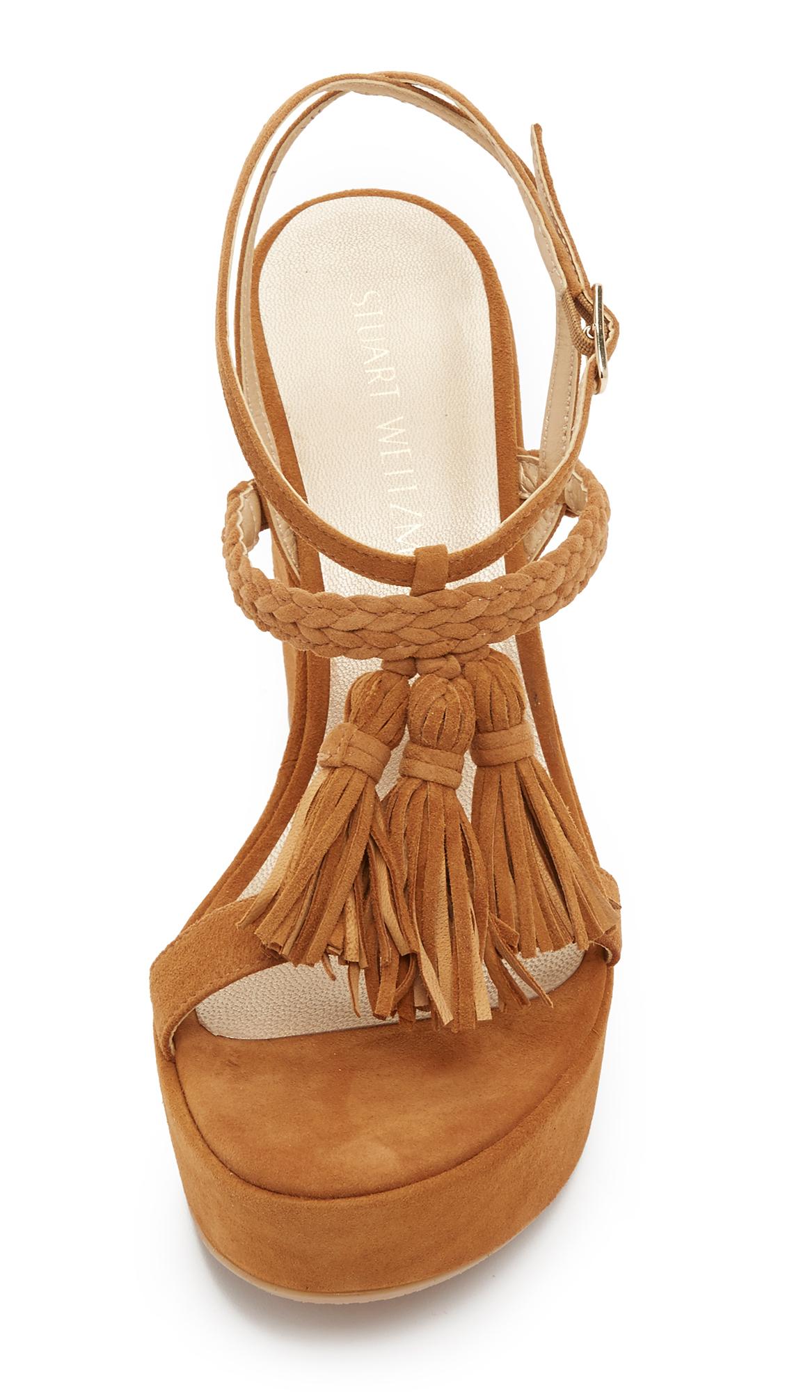 Lyst Stuart Weitzman Tassel Mania Wedge Sandals In Brown