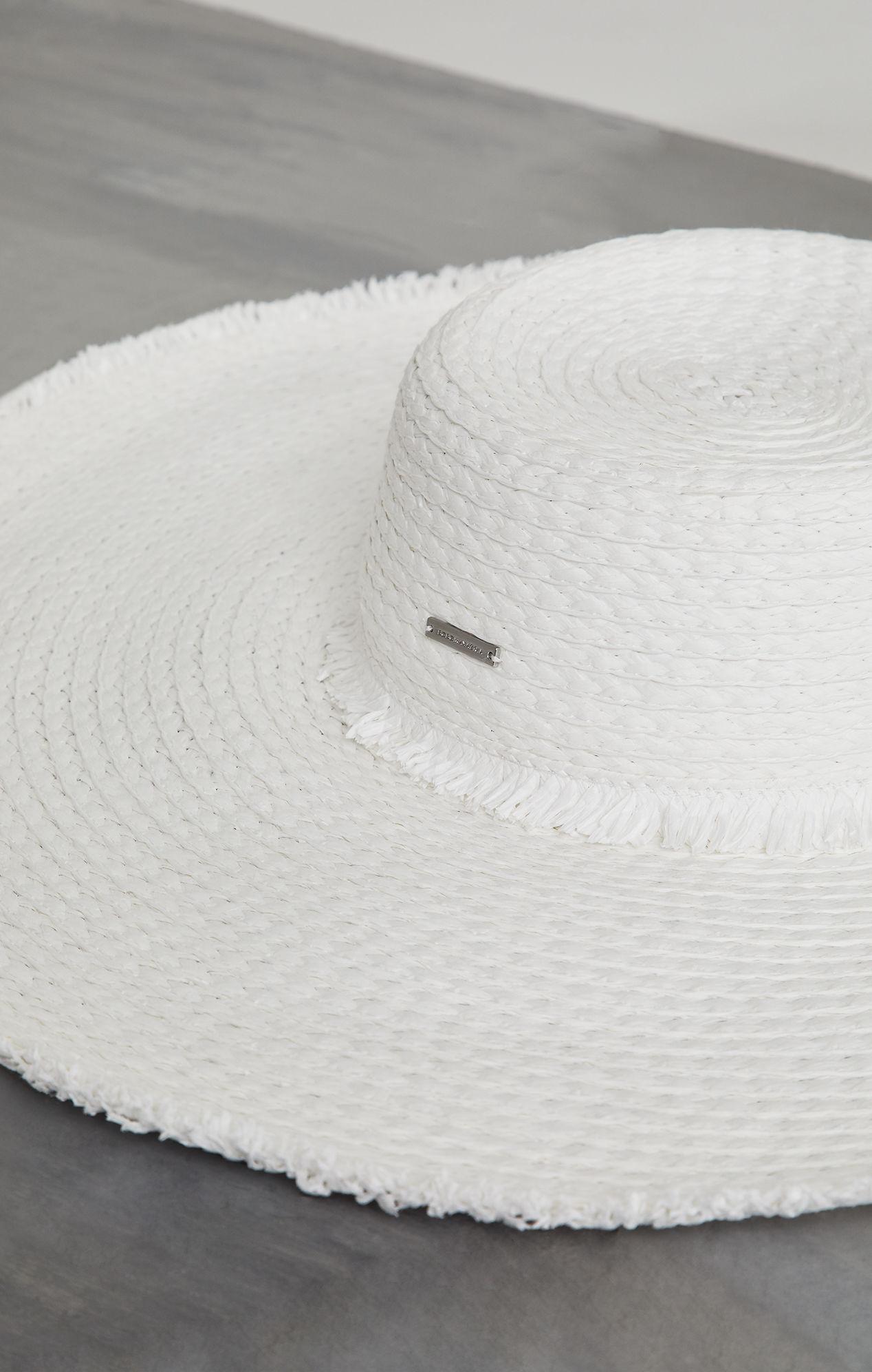 1bf28cf2 Lyst - BCBGMAXAZRIA Bcbg Frayed Edge Floppy Straw Hat in White