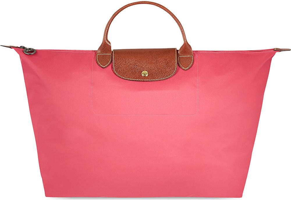 Longchamp le pliage large travel bag bonbon in pink lyst - Pliage serviette bonbon ...