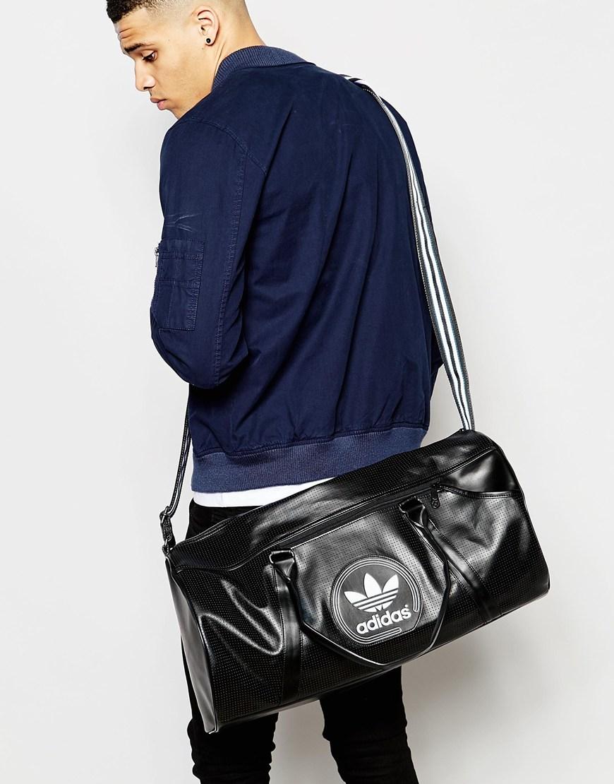 Lyst - adidas Originals Perforated Duffle Bag in Black for Men e7f001acc5df2