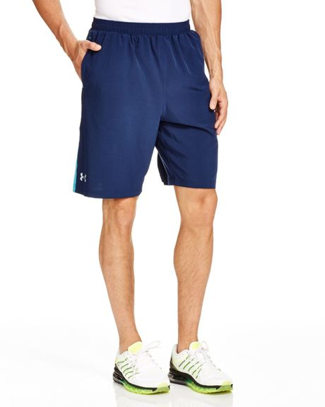 Under armour launch stretch woven shorts in blue academy for Thrilla in manila shirt under armour