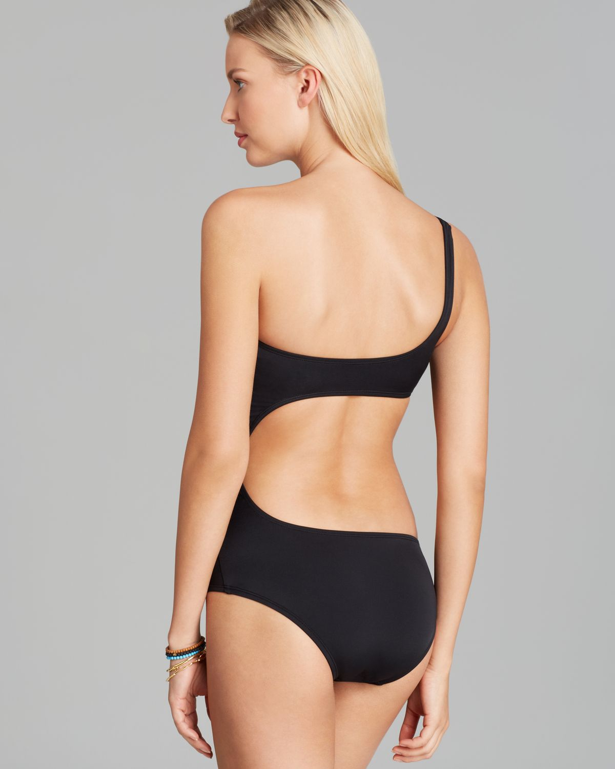 fad871525a1 DKNY Solid One Shoulder Asymmetrical Cut Out One Piece Swimsuit in ...