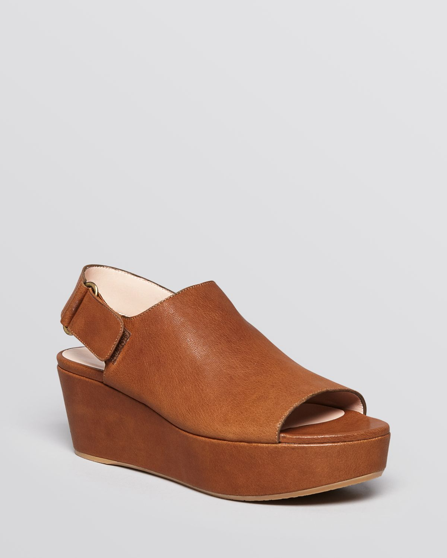 18c2500a0b2b Lyst - Stuart Weitzman Open Toe Platform Wedge Sandals Offset in Brown
