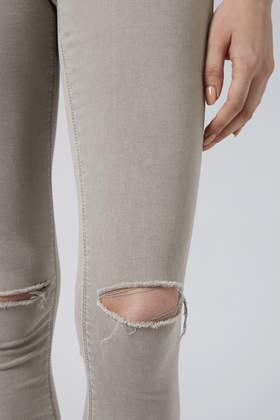 TOPSHOP Moto Light Grey Wash Ripped Leigh Jeans in Grey