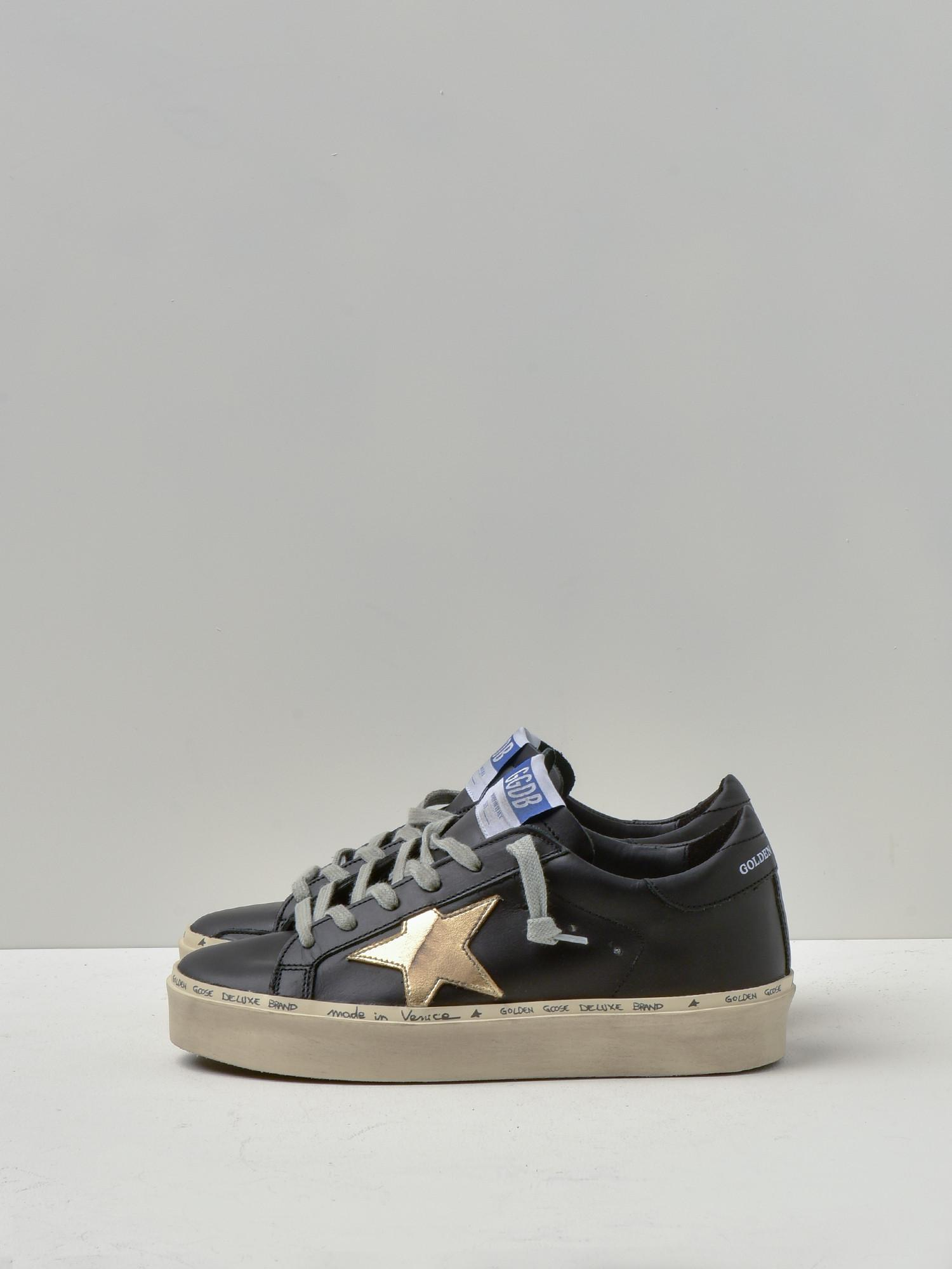 golden goose black and gold sneakers