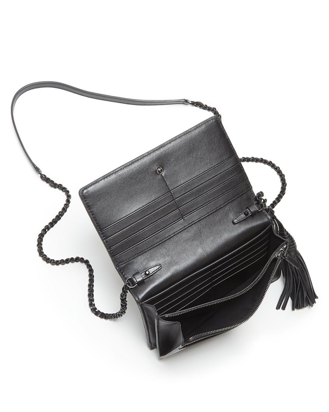 475773b33bb6 Lyst - Tory Burch Fleming Matte Flat Chain Wallet in Black