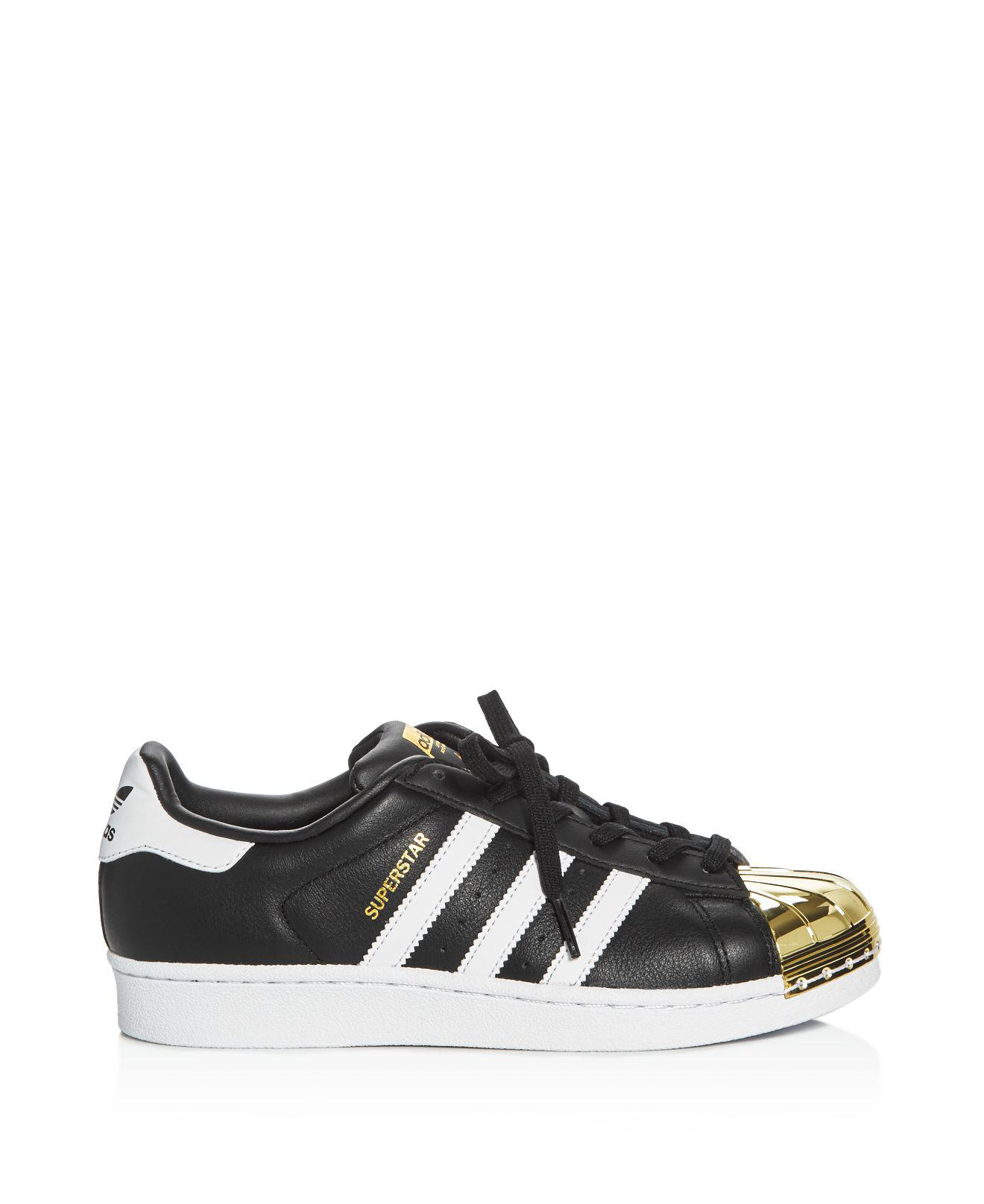 adidas Originals Leather Women's Superstar Metallic Toe Lace Up Sneakers in Black/White/Gold (Black)