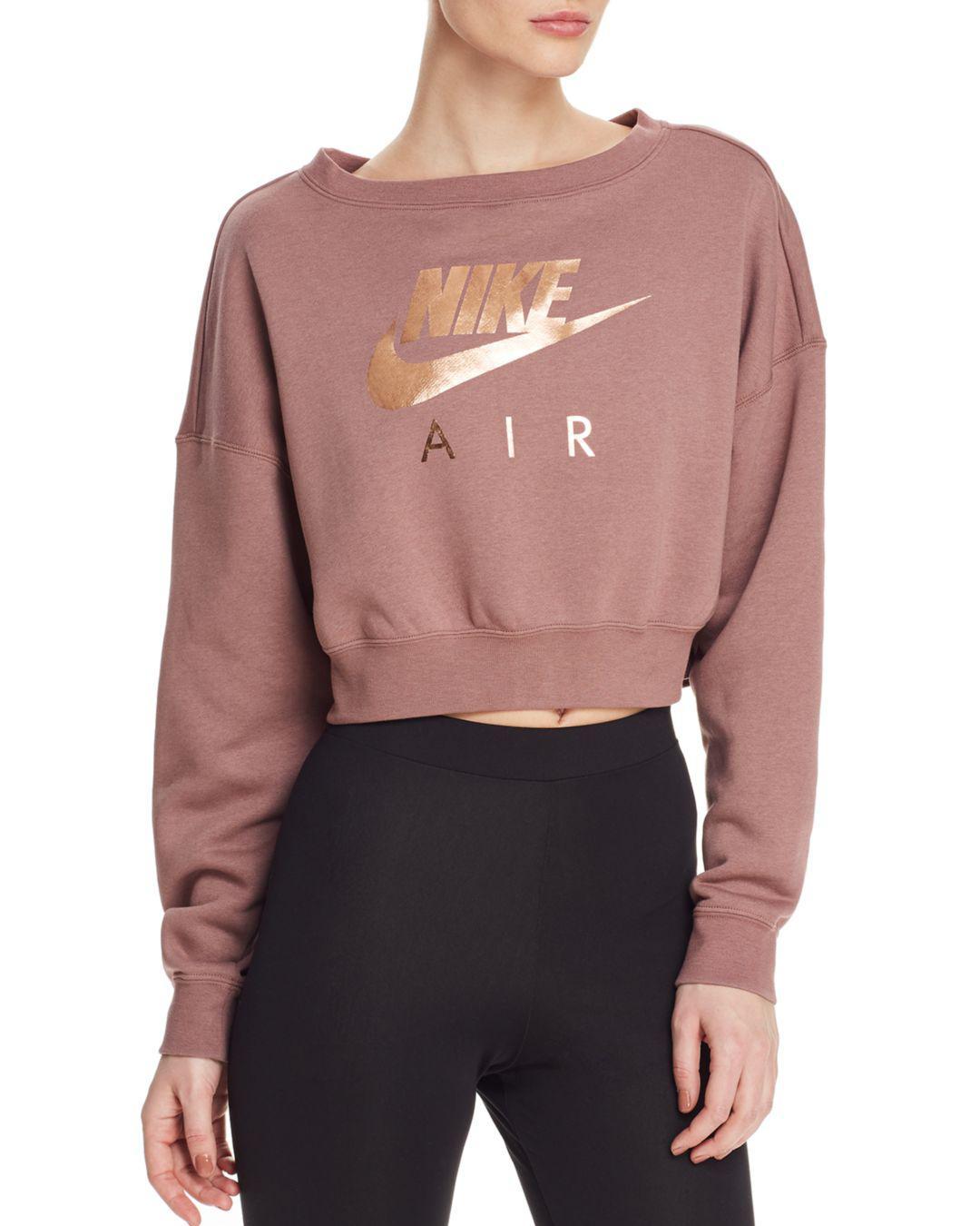 Nike Rally Air Cropped Sweatshirt Lyst [ 1350 x 1080 Pixel ]