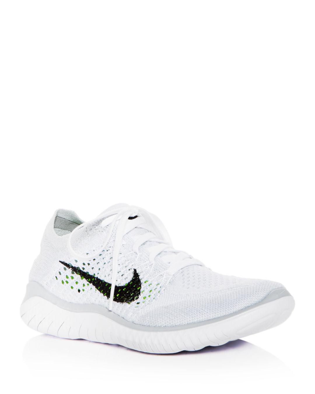 fb9550ce94f Lyst - Nike Women s Free Rn Flyknit 2018 Lace Up Sneakers in White ...