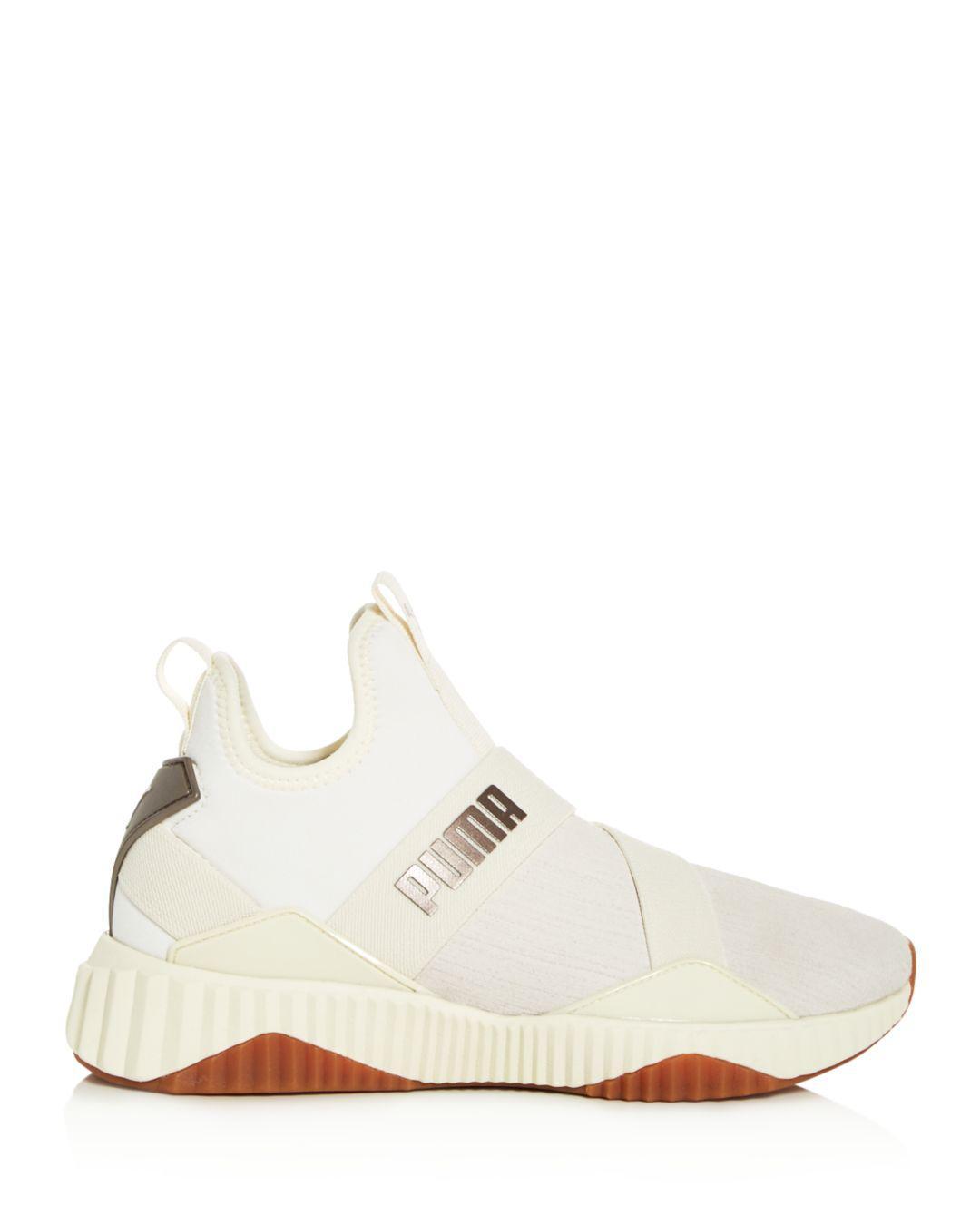 860e79025719 PUMA Women s Defy Luxe Mid-top Sneakers in White - Lyst