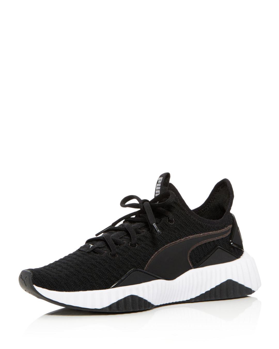 95f40b81f83202 Puma Women s Defy Knit Lace Up Sneakers in Black - Lyst