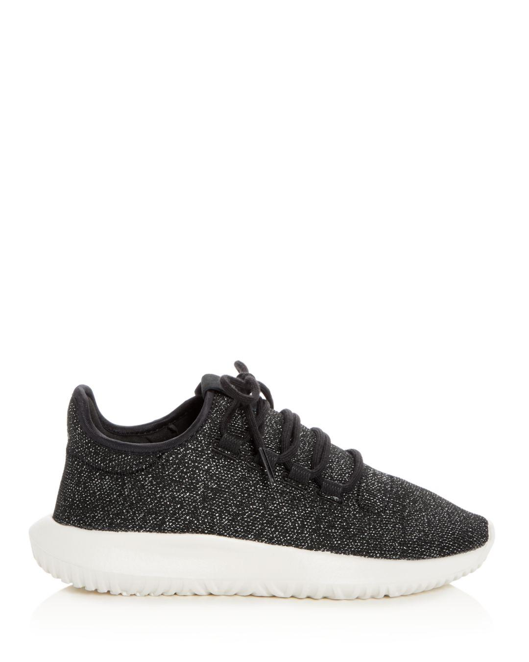fee953dc2fb828 Lyst - adidas Women s Tubular Shadow Glitter Knit Lace Up Sneakers in Black  - Save 67%