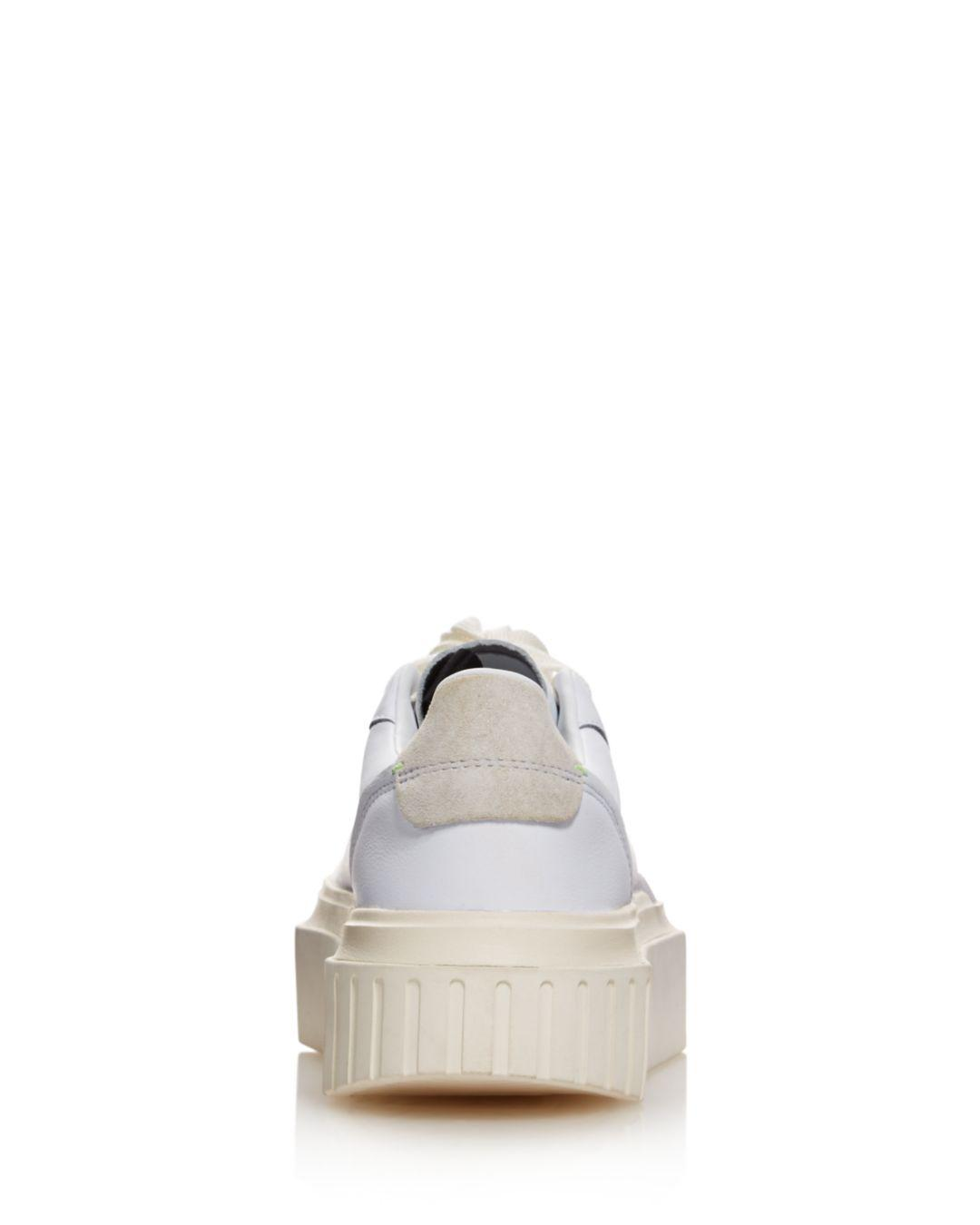0a5e1c37 Adidas White Hypersleek Leather Platform Sneakers