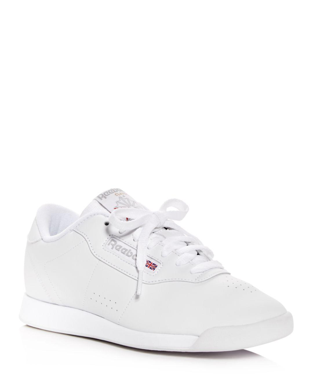 d812c5320bda24 Lyst - Reebok Women s Princess Faux Leather Lace Up Sneakers in White