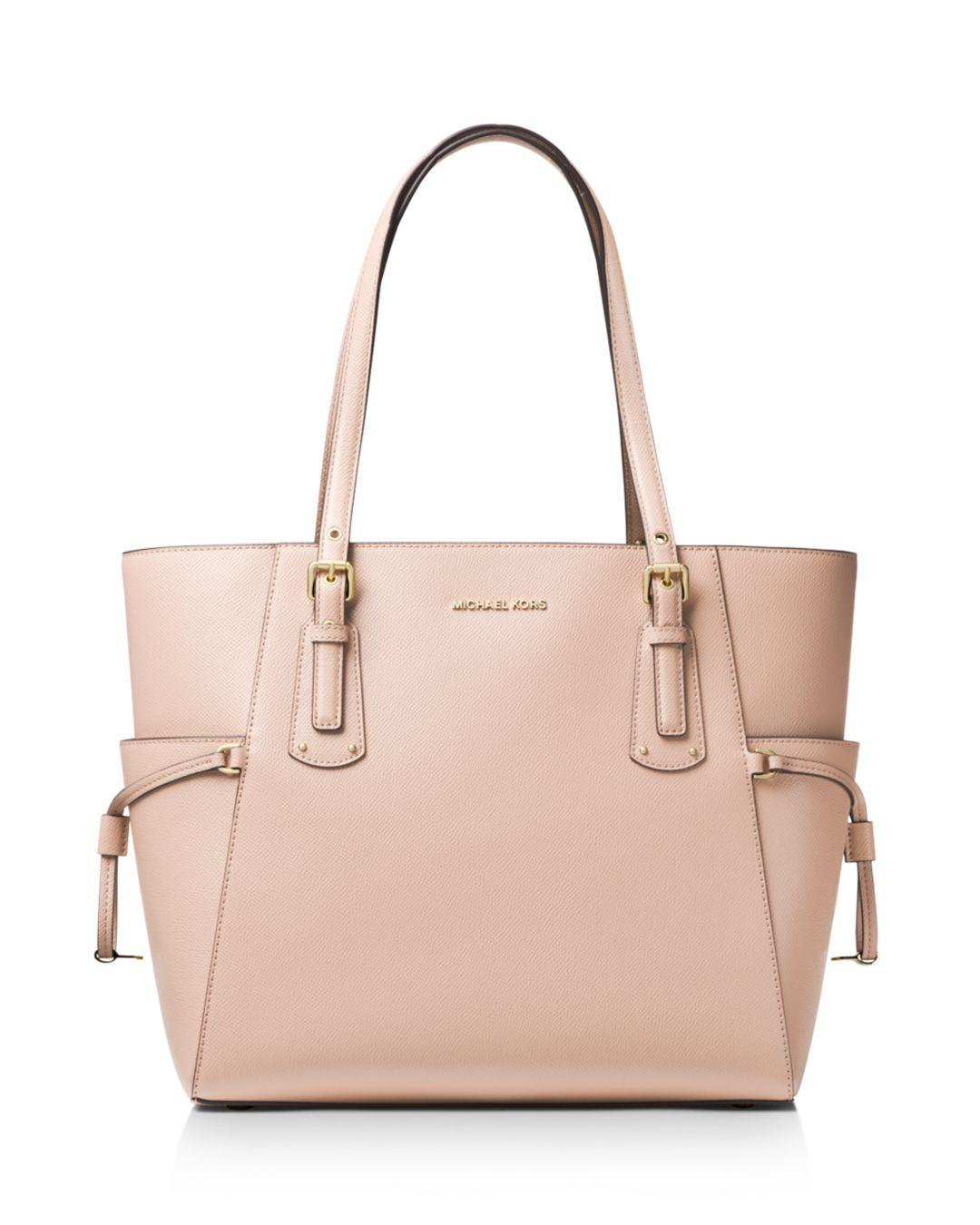699415b46c34 MICHAEL Michael Kors Voyager East West Leather Tote in Pink - Save ...