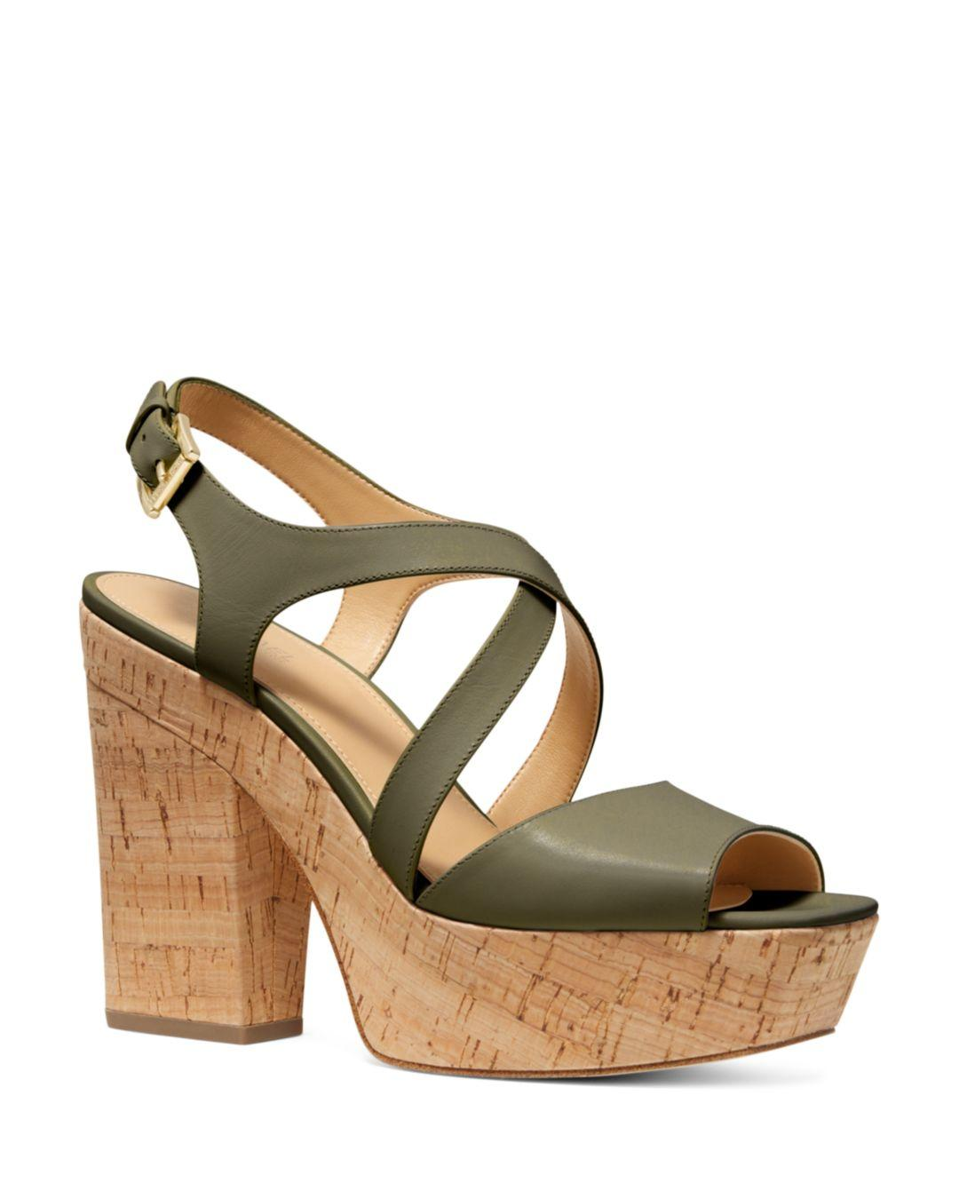 5d3c7bba390 MICHAEL Michael Kors. Green Women s Abbott Leather Platform Wedge Sandals