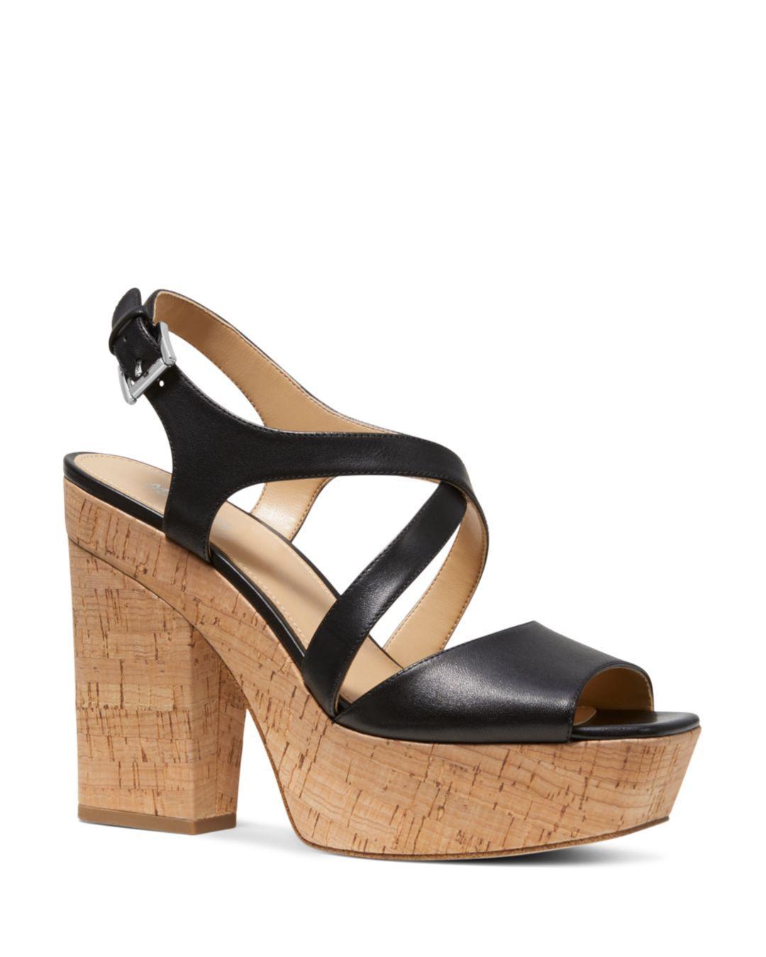 25e2d3fa084 MICHAEL Michael Kors. Black Women s Abbott Leather Platform Wedge Sandals