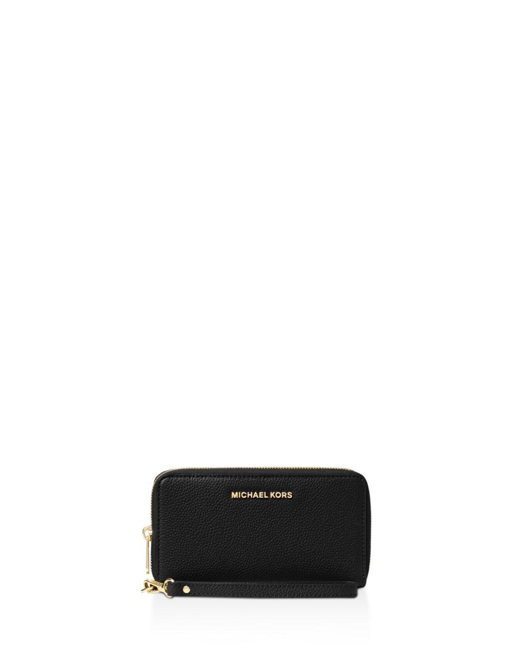 b673a6b2077d MICHAEL Michael Kors. Women's Black Flat Multi-function Large Leather  Smartphone Wristlet