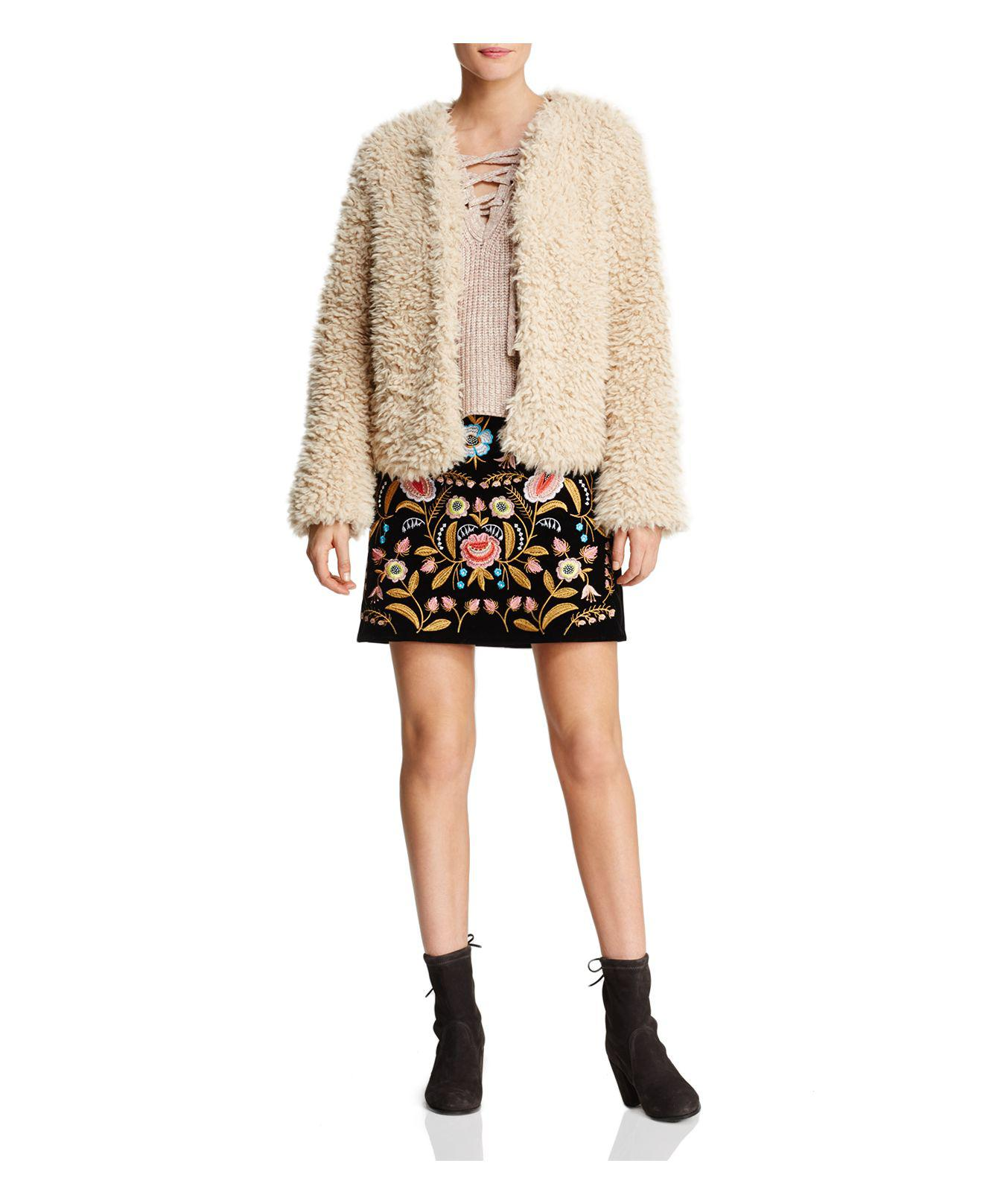 Lucy Paris Embroidered Mini Skirt in Black