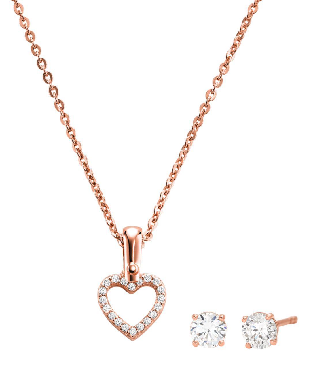 b2c543efb86fd Michael Kors. Women s Metallic Sterling Silver Cubic Zirconia Open Heart Pendant  Necklace ...