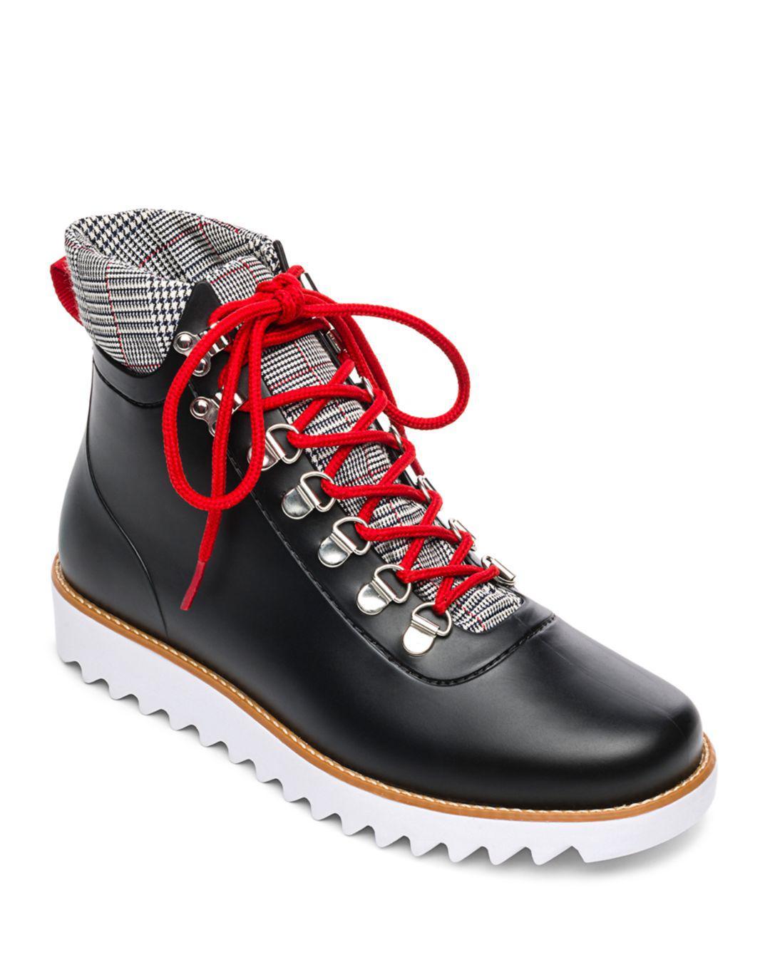 38b0623279dbef Lyst - Bernardo Winnie Lace-up Rubber Rain Boots in Black