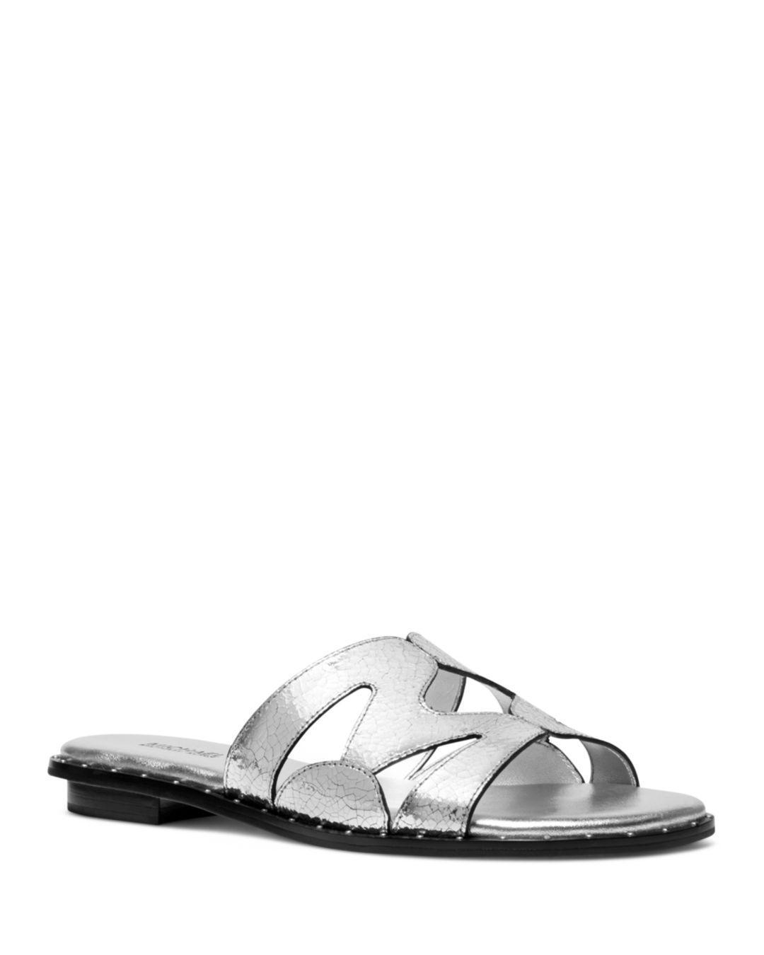 9c5d98e207a7 Lyst - Michael Kors Annalee Metallic Textured Leather Slide in Metallic
