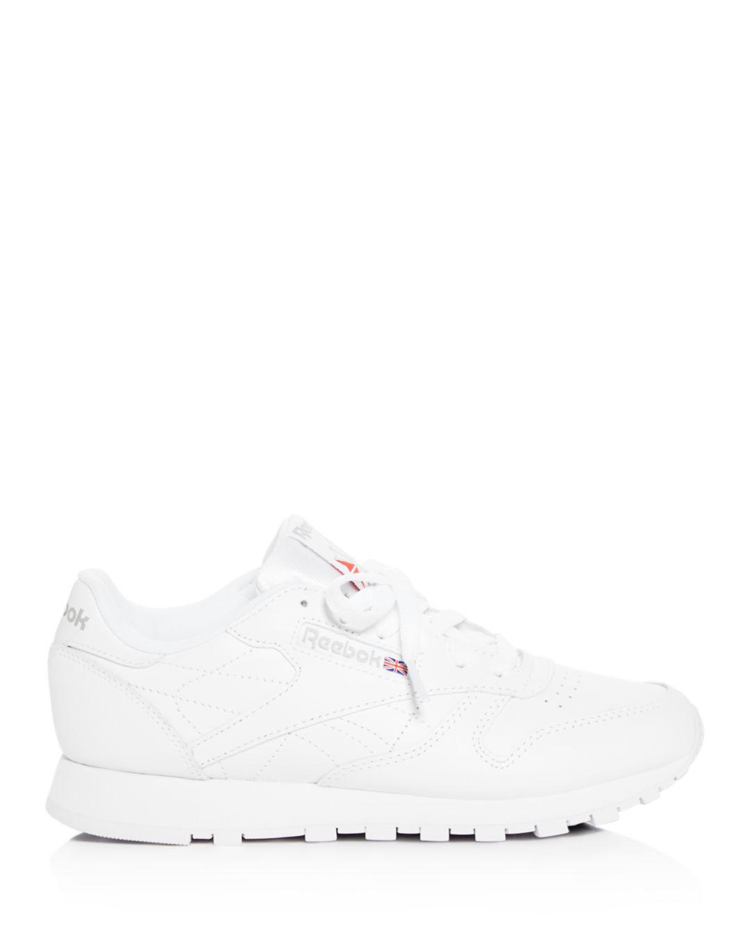 a08b5cbf09c Lyst - Reebok Women s Classic Leather Lace Up Sneakers in White
