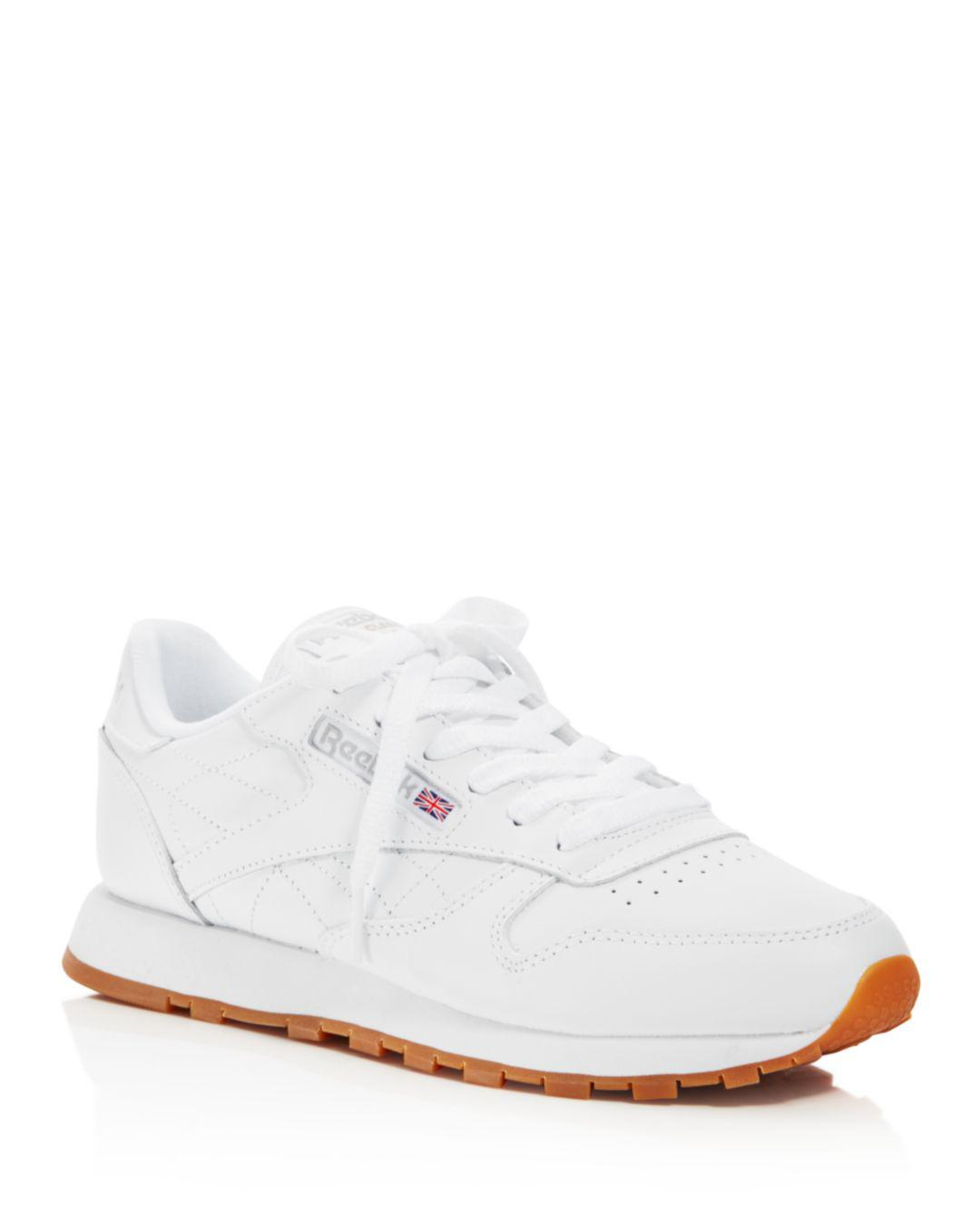 cf1144e63bb3 Lyst - Reebok Women s Classic Leather Lace Up Sneakers in White