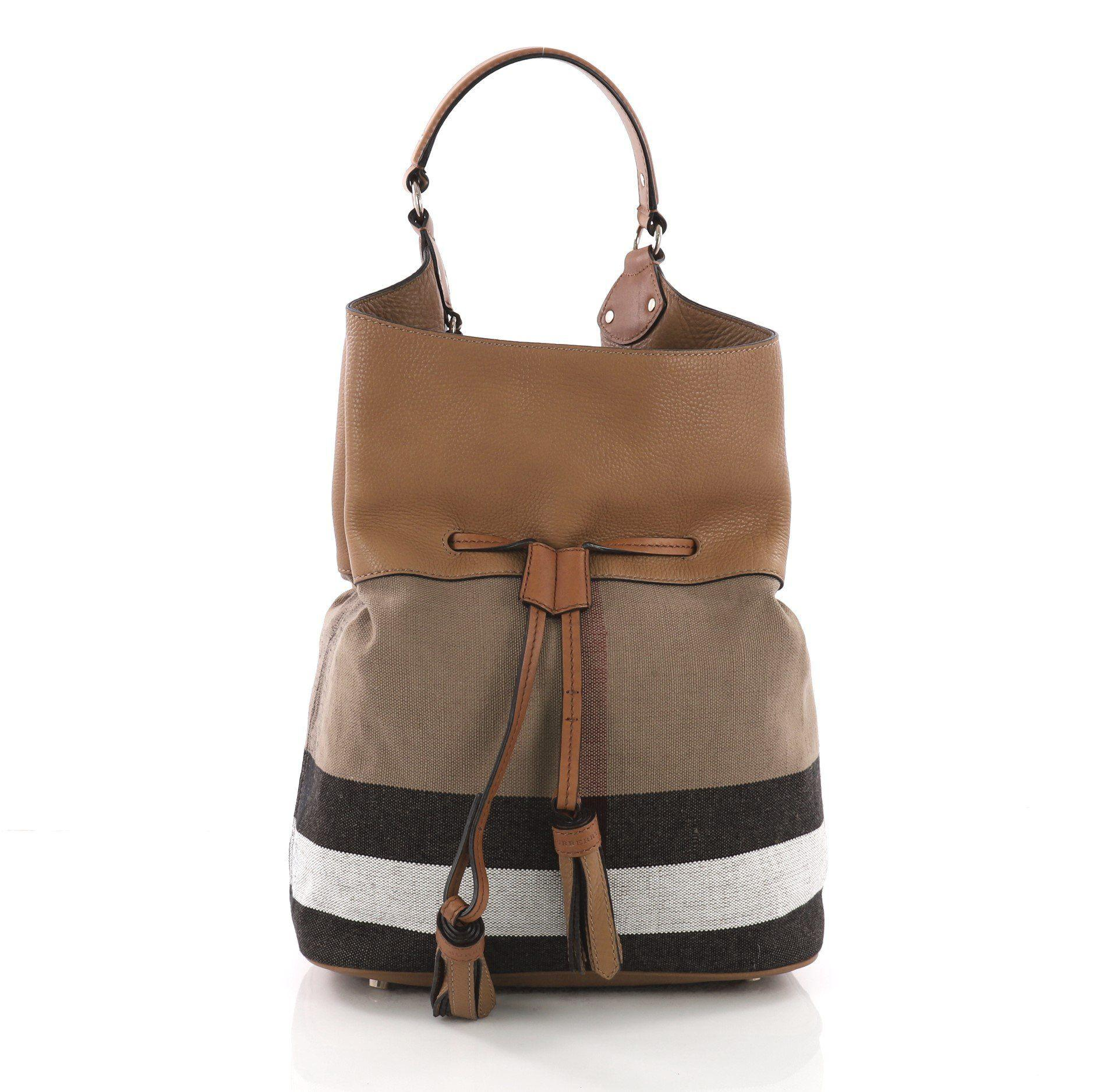 a17ec411aa38 Burberry. Women s Brown Pre Owned Ashby Drawstring Handbag House Check  Canvas ...