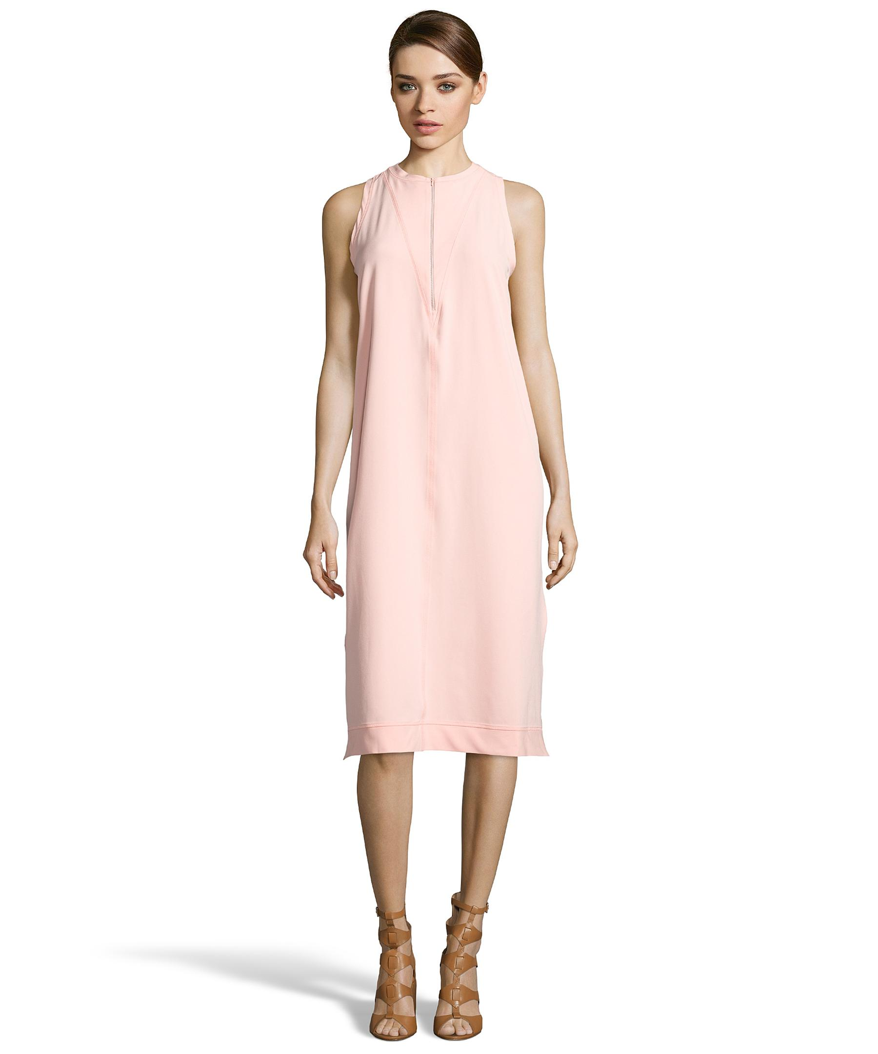 Flaunt a short pink lace shift dress that blends romance and comfort. This soft short party dress features a stylish relaxed design and a spandex-lace fabric for a cute look at any special celebration.