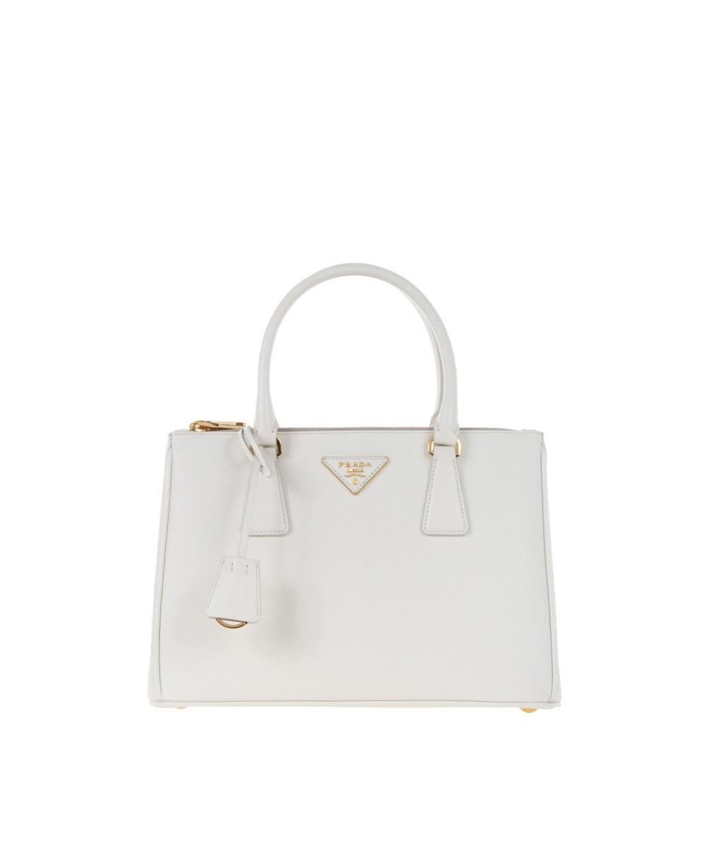 7fc9de1997 Prada Women s White Leather Handbag in White - Lyst