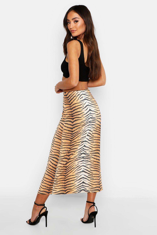 c9e7e72e2 Boohoo - Orange Petite Tiger Print Slinky Midi Skirt - Lyst. View fullscreen
